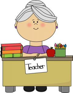 gray-teacher-sitting-at-desk